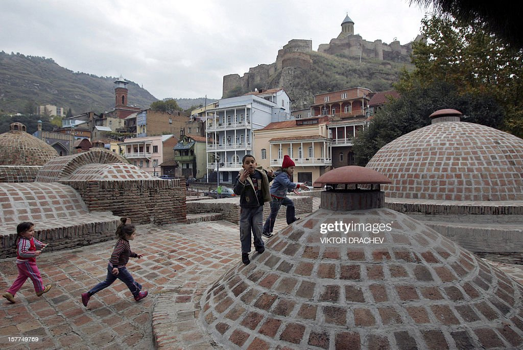 Children run in central Tbilisi 11 November 2007 A top US diplomat arrived in Georgia Sunday to push President Mikheil Saakashvili to lift a state of...