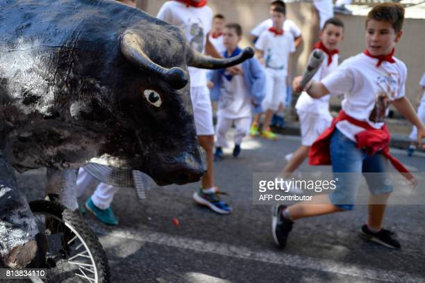 Children run in the 'Encierro Txiki' during the San Fermin Festival in Pamplona northern Spain on July 13 2017 The festival is a symbol of Spanish...