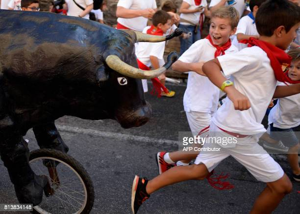 TOPSHOT Children run in the 'Encierro Txiki' during the San Fermin Festival in Pamplona northern Spain on July 13 2017 The festival is a symbol of...