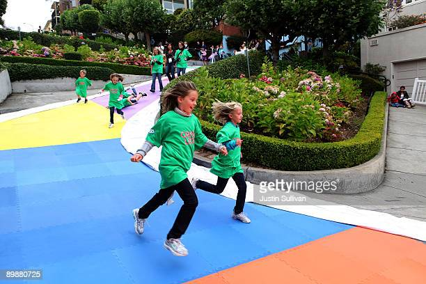 Children run on colored squares that decorate Lombard Street as they play the world's largest game of Candyland August 19 2009 in San Francisco...