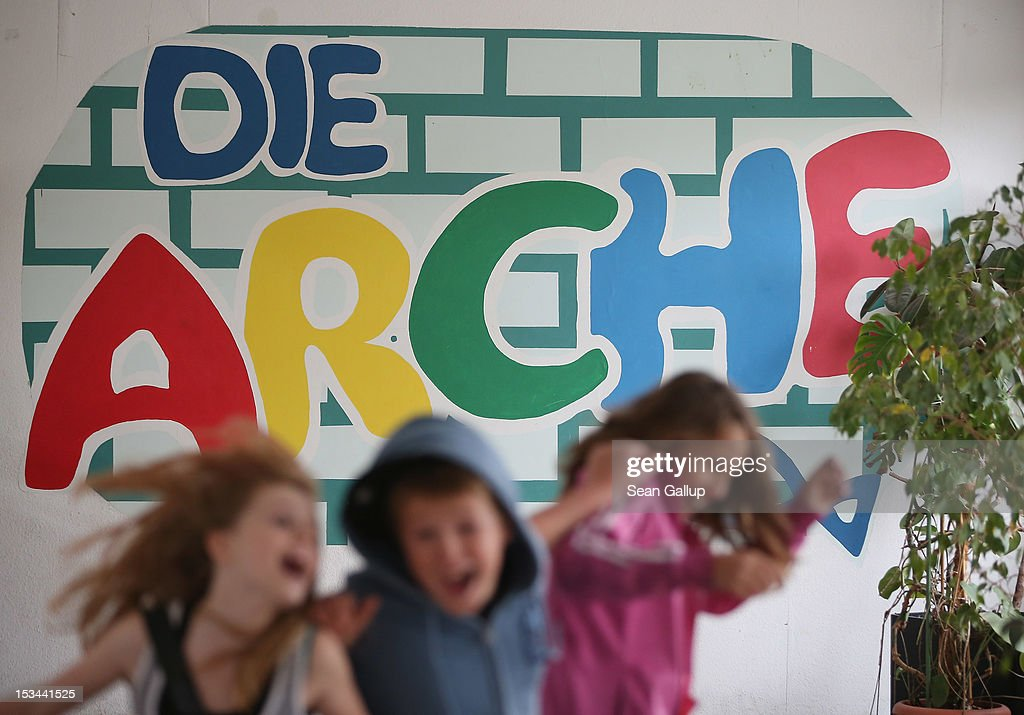 Children run through the entrance hall at the 'Arche' youth center in Marzahn-Hellersdorf district on October 5, 2012 in Berlin, Germany. The Arche (which means Ark) is a Christian-based facility that provides children of all ages with a hot lunch, help with homework, arts and play facilities and in general a welcome place to come to in Marzahn-Hellersdorf district in east Berlin, a district with high levels of unemployment and social problems. An employee said up to 90% of the children come from challenged families and that many arrive at Arche illiterate.