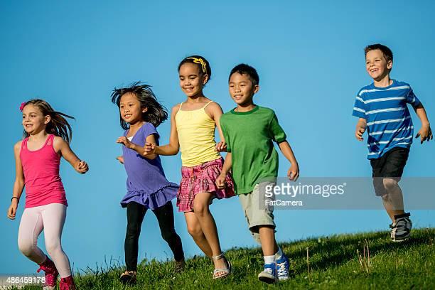Children Runnign Down Grassy Hill