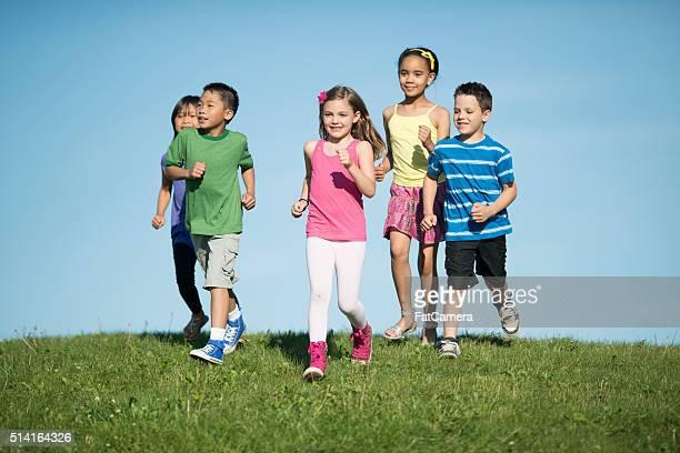 Children Running Down a Hill