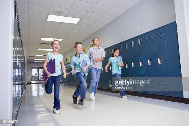 Children running down school corridor