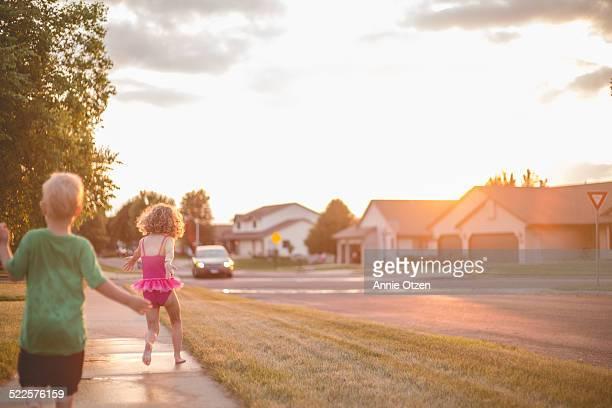 Children Running down sidewalk