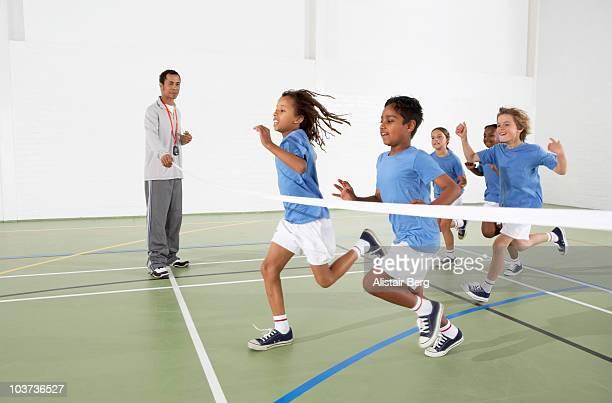 Children running in a gymnasium