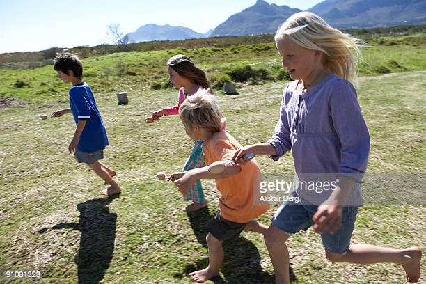 Children running in egg and spoon race