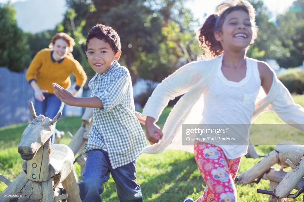 Children running in field : Stock Photo