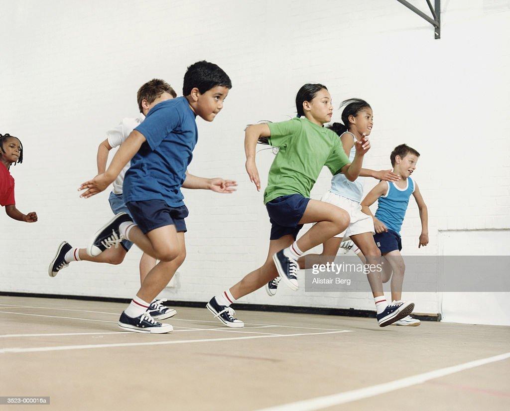 Children Running in Gymnasium
