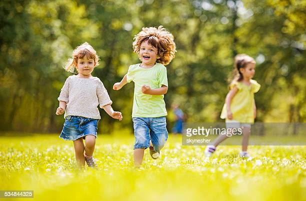Children running in park.