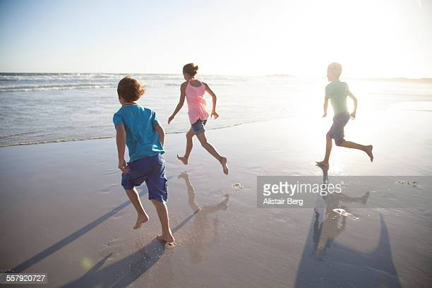Children running into sea together