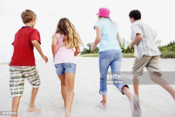 Children running on beach
