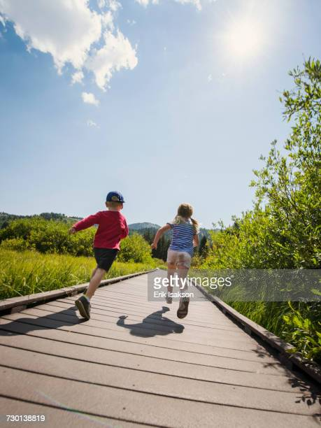 Children (4-5) running on boardwalk