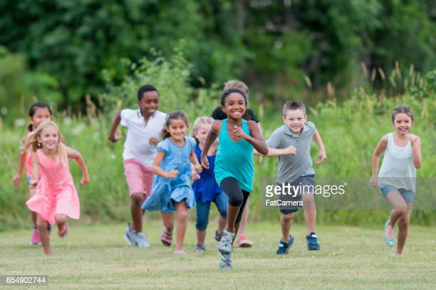 Children Running Outside at Recess