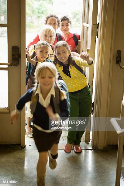 Children running through door