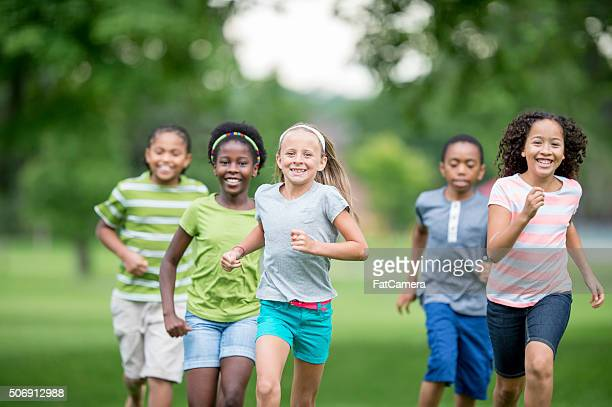 Children Running Through the Grass