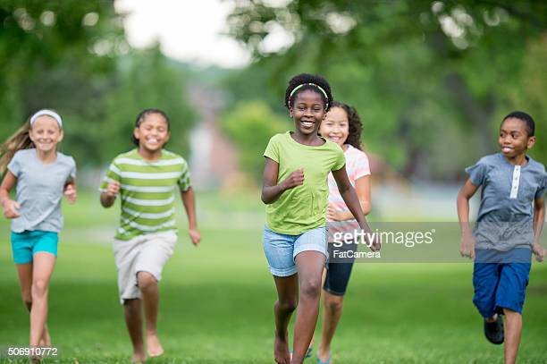 Children Running Through the Park