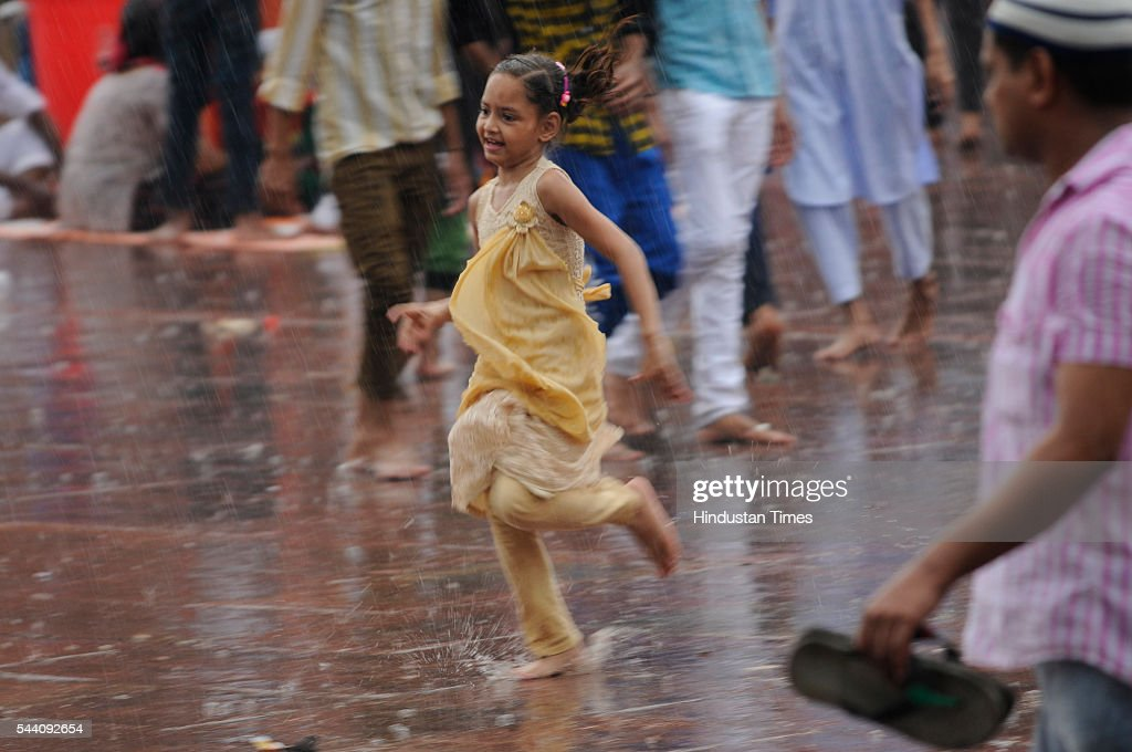 Children running to shield themselves from rains near Jama Masjid on July 1, 2016 in New Delhi, India. The capital received its first Monsoon rains dragging the maximum temperatures several notches below normal. Heavy downpour caused water logging and traffic jams in the city.
