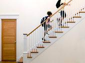 Children running up stairs after school