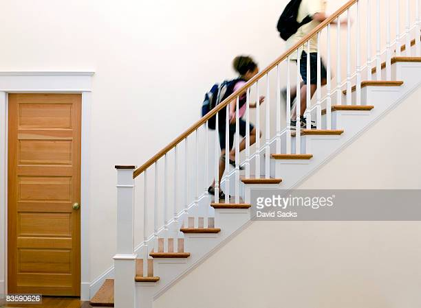 Children running up stairs after school