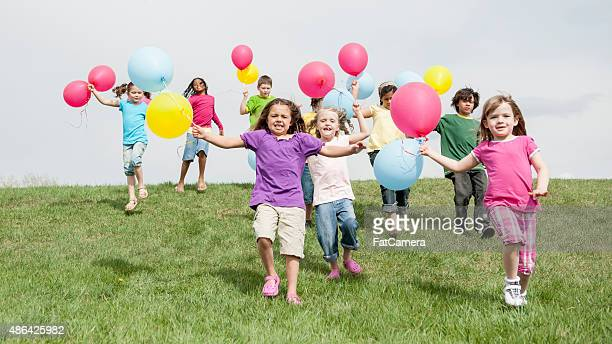 Children Running with Balloons