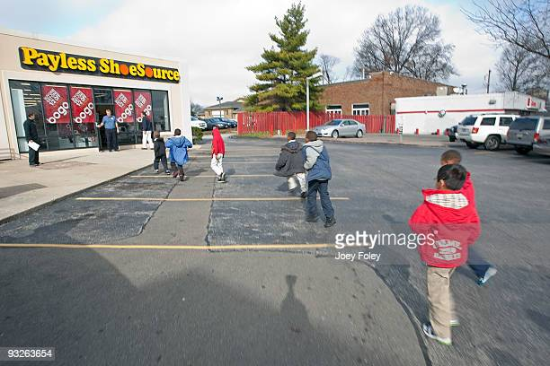 Children rush for the door to use their coupons for free shoes at Payless ShoeSource on November 20 2009 in Cincinnati Ohio