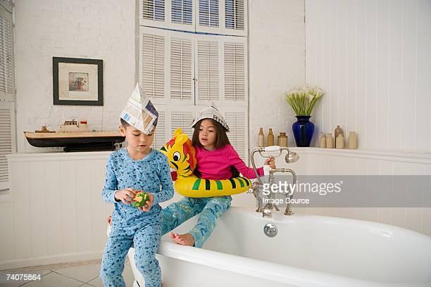 Children sat on bath tub