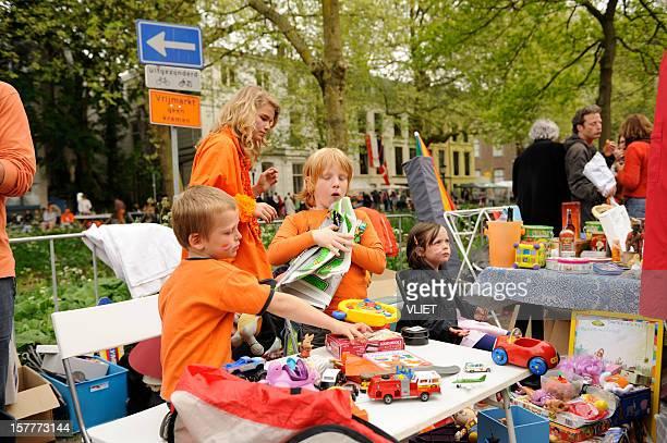 Children selling toys on Queen's day in Utrecht