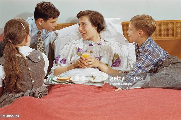 Children Serving Mother Breakfast in Bed