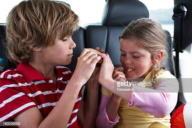 Children sharing a hamburger