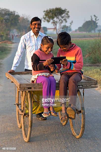 Children sharing tablet device