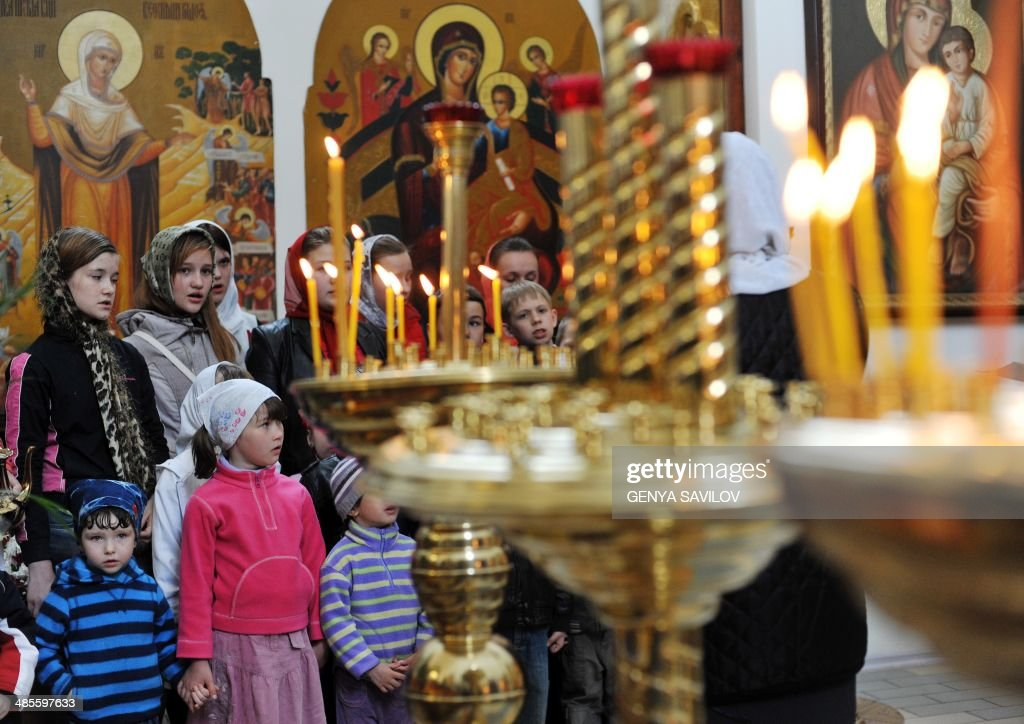 Children sing prayers during a service in the cathedral of the eastern Ukrainian city of Slavyansk on April 19, 2014, on the eve Easter celebrations, the main religious holiday of the Orthodox church.