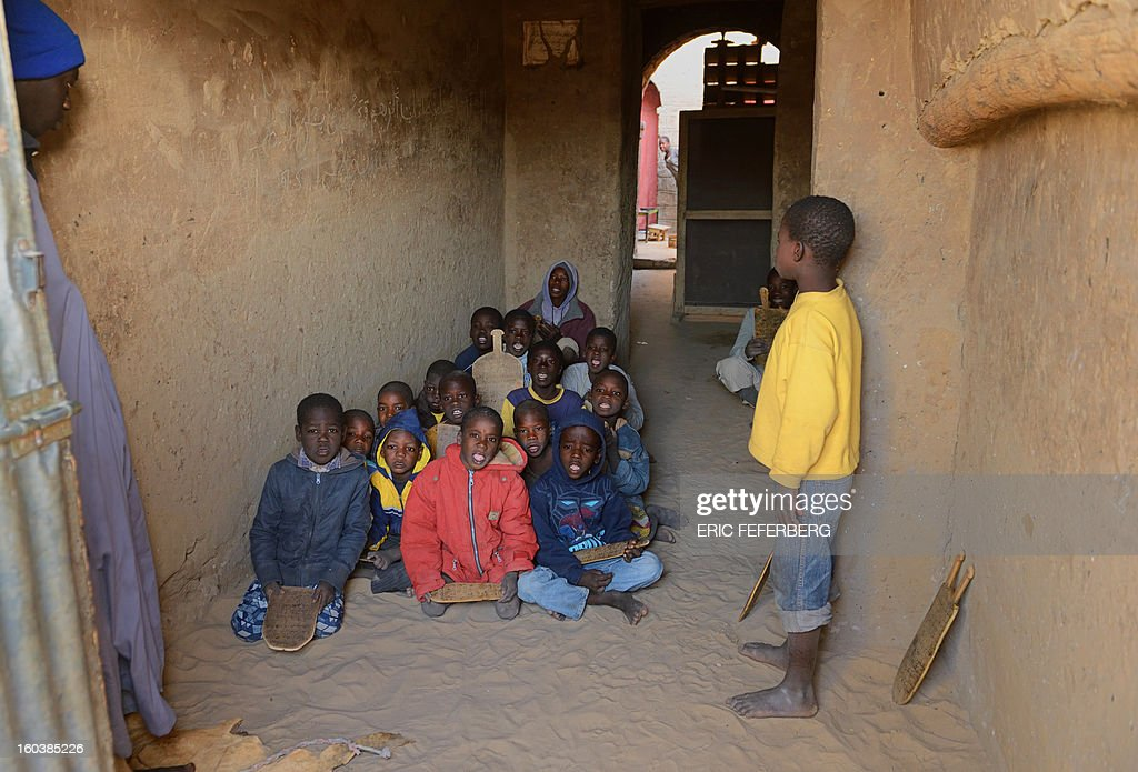 Children sing psalms as part of their religious studies with a marabout in Timbuktu, on January 30, 2013. French troops have taken up position today at the airport in Kidal, local sources said, the third major city in northern Mali after Gao and Timbuktu.