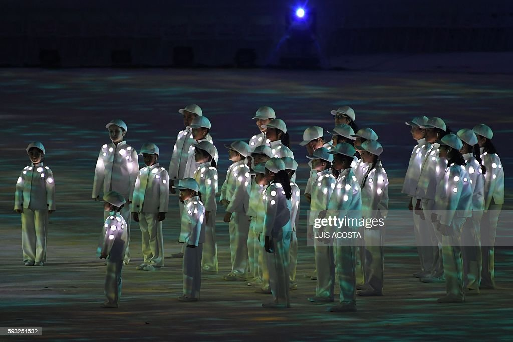 Children sing the Brazilian national anthem during the closing ceremony of the Rio 2016 Olympic Games at the Maracana stadium in Rio de Janeiro on...