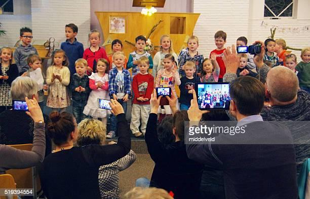 Children singing in Church