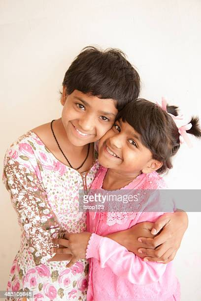 Children. Sisters from India standing outdoors.
