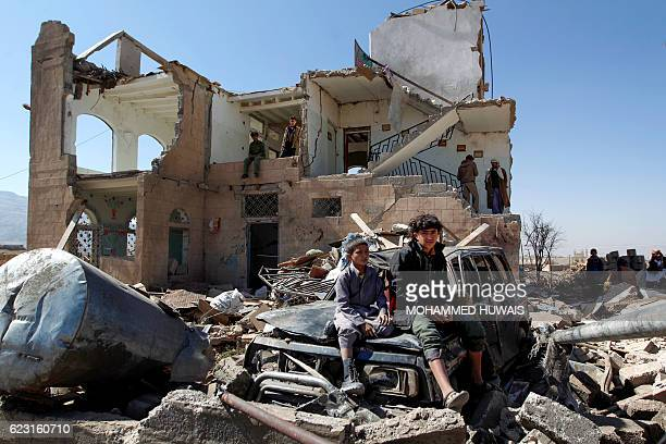 TOPSHOT Children sit amidst the rubble of a house hit by Saudiled coalition air strikes two days earlier on the outskirts of the Yemeni capital Sanaa...