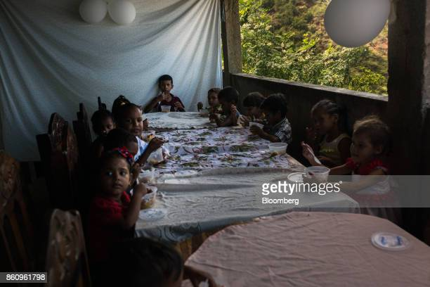 Children sit for lunch at a community meal program that Jose Manuel Olivares opposition coalition governor candidate for Vargas State not pictured...