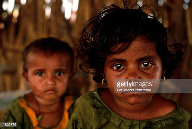 Children sit in a camp for freed bonded slaves July 28 1996 in Matli Pakistan These untouchables are sold from from land owner to land owner in...
