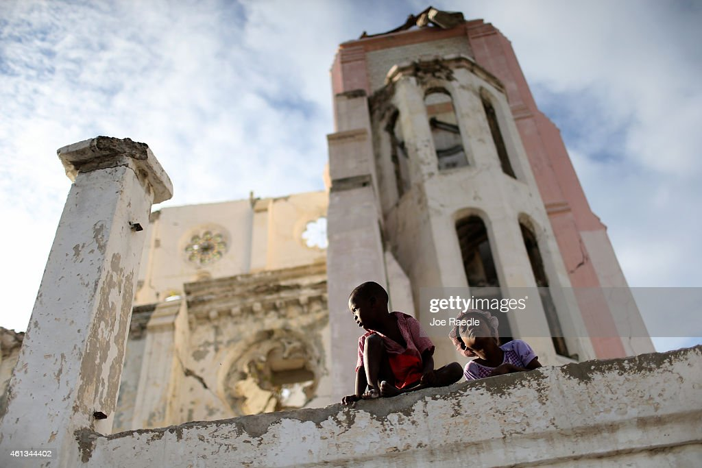 Children sit on the wall next to the National Cathedral that was destroyed five years ago by a magnitude 70 earthquake that struck just before 5 pm...