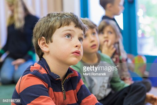 Children sitting and listening in classroom