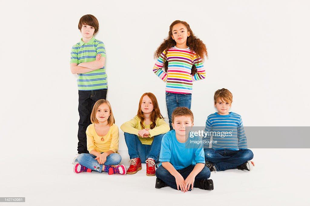 Children sitting and standing : Stock Photo