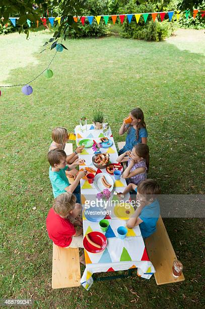 Children sitting at table on a birthday party
