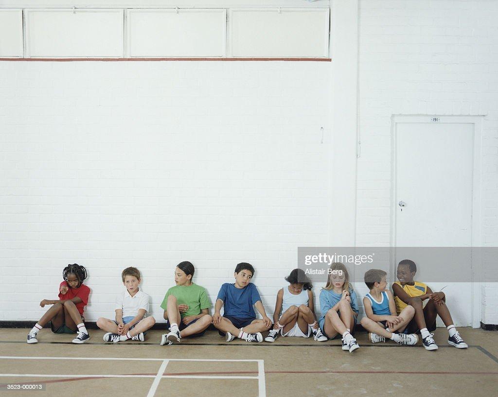 Children Sitting in Gymnasium