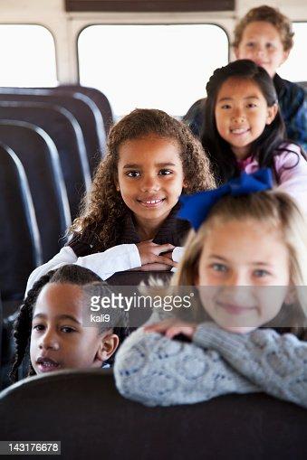 Children sitting inside school bus : Stock Photo