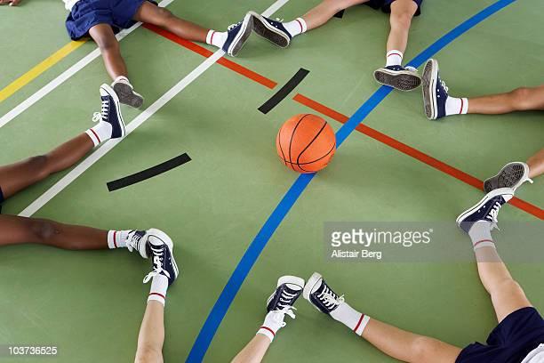 Children sitting on floor of gymnasium