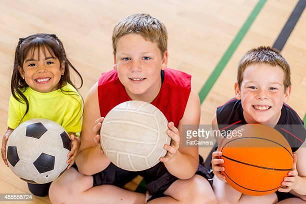 Children Sitting on Gym Floor
