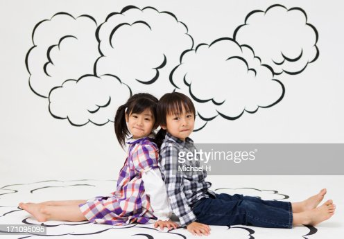Children sitting on the cloud : Stock Photo