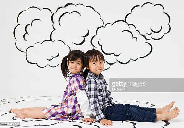 Children sitting on the cloud