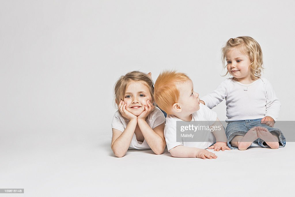 Children sitting together : Stock Photo